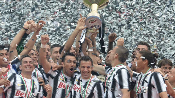 Juventus players celebrate their Serie A title success after going through the 2011-12 league season unbeaten to relegate arch-rivals AC Milan to second place.