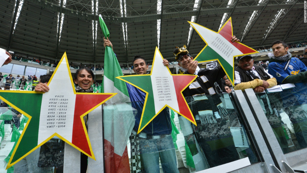 "Juventus fans hold up three stars to signify the 30 championships won by the club, but two in 2005 and 2006 have been struck off the official records after the ""Calciopoli"" match-fixing scandal."