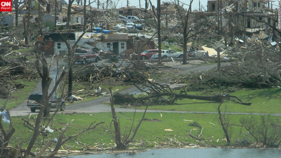 "<a href=""http://ireport.cnn.com/people/missyjenjen"">Jennifer Parr</a> shot this photo in southwest Joplin two days after the tornado. ""As devastating as the scenes are, I felt I should take these pictures to help document the aftermath of this historic storm,"" she said at the time."