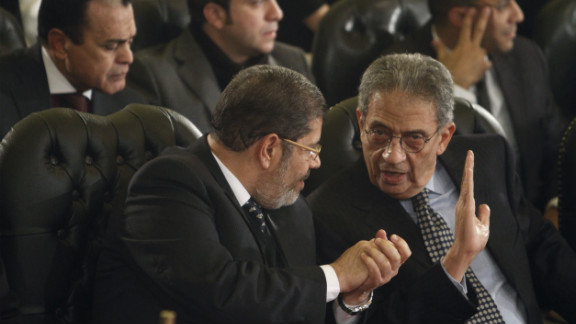 Leader of the Freedom and Justice Party, Mohamed Morsi (left).
