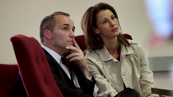 Former Edwards aide Andrew Young and his wife, Cheri, listen during a 2010 hearing in North Carolina. Defense attorneys argued that Young used the money for his own gain and to pay for Hunter