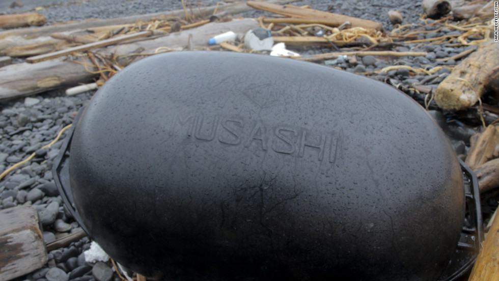 "A plastic float bearing the Japanese name ""Musashi"" is among the rubbish on Montague Island."