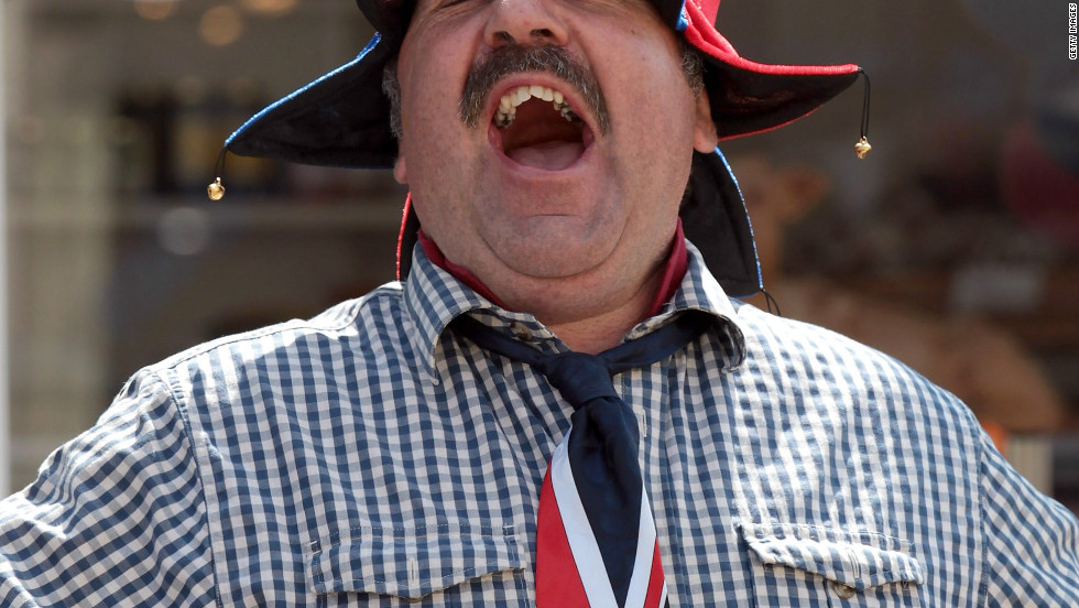 A Porlock resident gets into the Olympic spirit as the torch passes through his town on day three of the relay. Crowds have turned out in their hundreds to cheer on the flame as it makes its 8,000-mile journey across the UK.