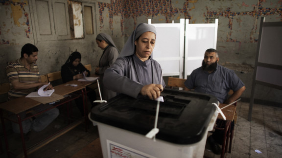 An Egyptian Coptic nun drops her ballot at a Cairo polling station Wednesday.