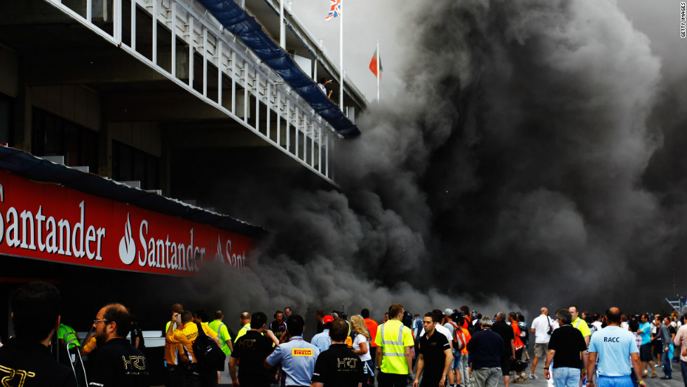 The team's post-race celebrations were cut short by a fire in their garage, and smoke from the blaze engulfed the pit lane at the circuit in Catalunya.