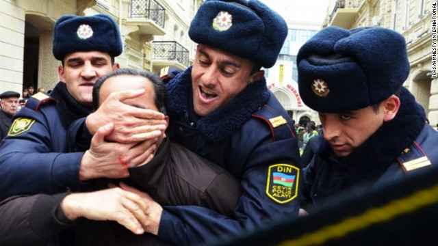 Police officers manhandle a political activist during a protest in Baku, Azerbaijan, on 12 March 2011.
