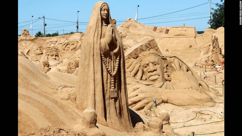 A sand sculpture of Our Lady of Fatima stands Wednesday at the International Sand Sculpture Festival in Armacao de Pera, Portugal.