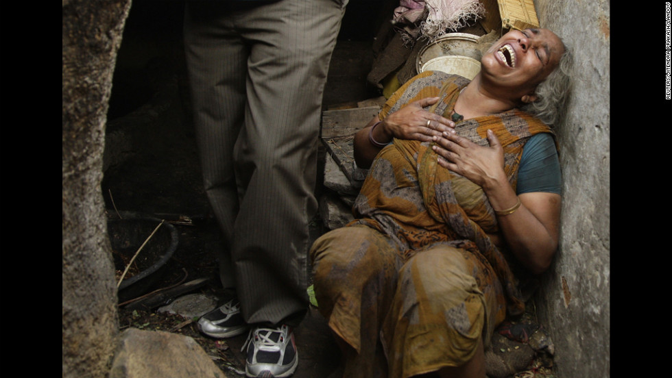 Sabra Begum, a relative of a victim of an explosion, weeps Wednesday in a slum area in the north Indian city of Allahabad.