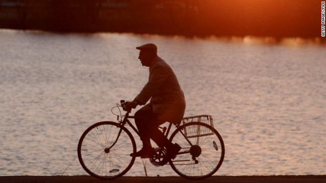 A man rides his bike in Cambridge, Massachusetts. The state ranked as third most bicycle-friendly in the nation.