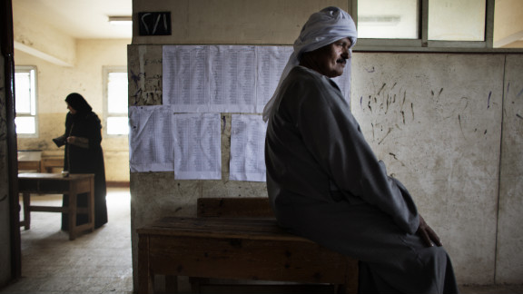 An Egyptian man waits to cast his ballot Thursday north of Cairo. The vote is considered Egypt