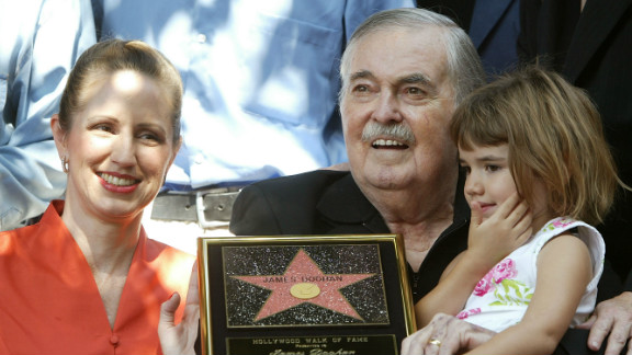 Actor James Doohan celebrates getting a star on the Hollywood sidewalk in 2004 with his wife, Wende, and daughter Sarah.