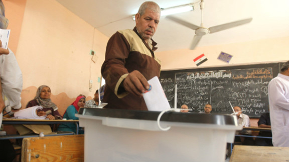 An Egyptian man drops off his ballot at a polling station Thursday in Cairo. The voting marks the first time Egypt has held a presidential election in which the results aren