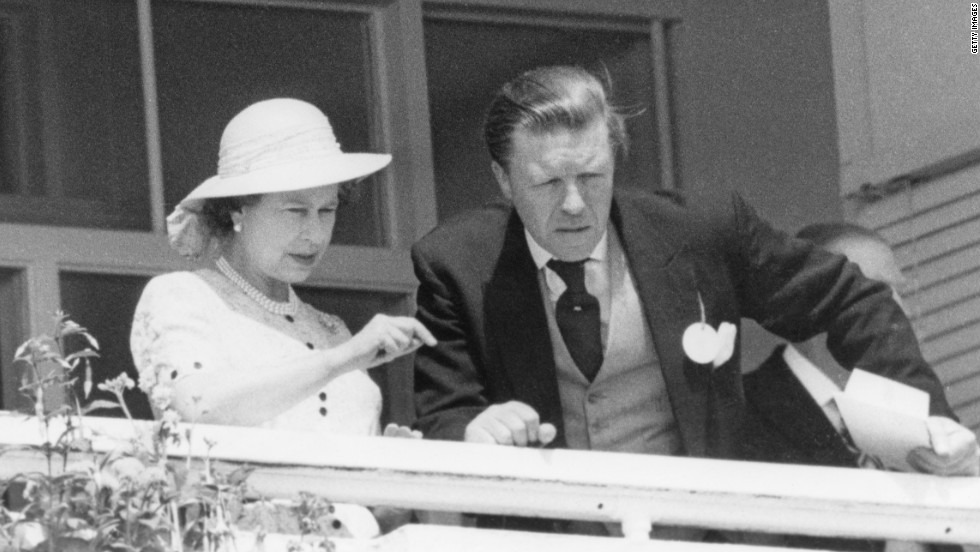 "Queen Elizabeth II seen here with stud manager Sir Michael Oswald, watching the Derby in 1980. One of the queen's trainers, Andrew Balding says: ""She is a very well informed and keen owner, probably the best-informed owner in the country."""