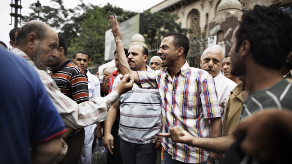 Supporters of various candidates debate outside Al-Fatah Mosque in Cairo on Friday.