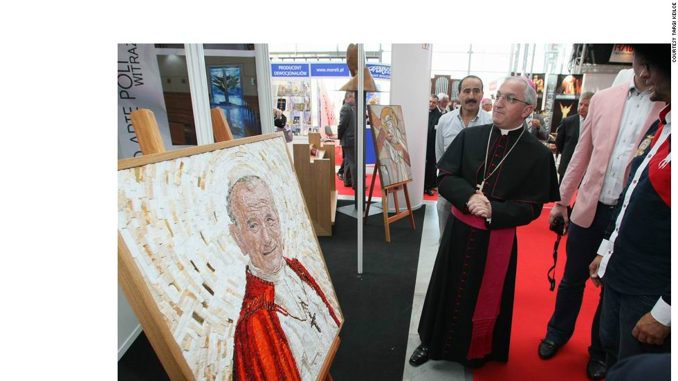Apostolic Nuncio to Poland Archbishop Celstino Migliore gets a grand tour of the reliquaries and kitsch on show at last year's expo.
