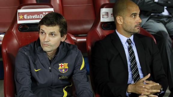 Pepe Guardiola and his successor Tito Vilanova sit in the dug out during the Copa del Rey final win.