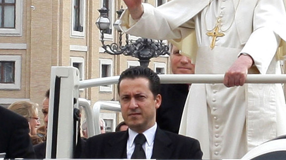 "Paolo Gabriele rides in the ""Popemobile"" with Pope Benedict XVI in St. Peter"