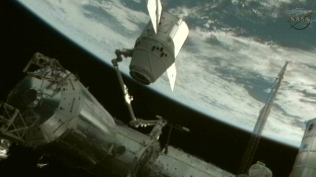 Space station nabs 'Dragon by the tail'