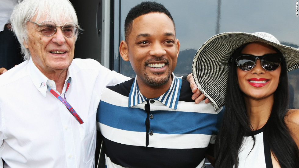 F1 supremo Bernie Ecclestone with Hollywood actor Will Smith and Lewis Hamilton's girlfriend Nicole Scherzinger.