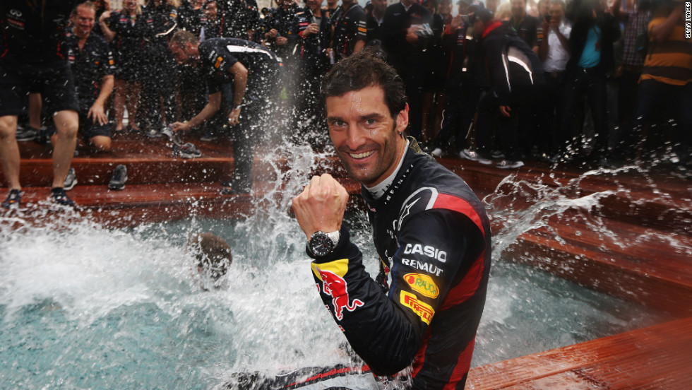 Webber takes a post-race dip as the Red Bull team celebrate a third consecutive Monaco triumph.