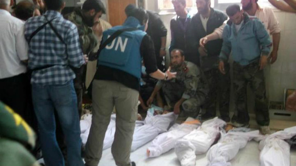 U.N. observers visit a hospital morgue in Houla on Saturday before the burial of massacre victims. Opposition activists and residents blame al-Assad