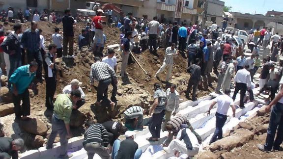 """Syrians gather at a mass burial Saturday in Houla. """"Those responsible for these brutal crimes must be held accountable,"""" Kofi Annan, the U.N.-Arab League special envoy, said in a statement."""