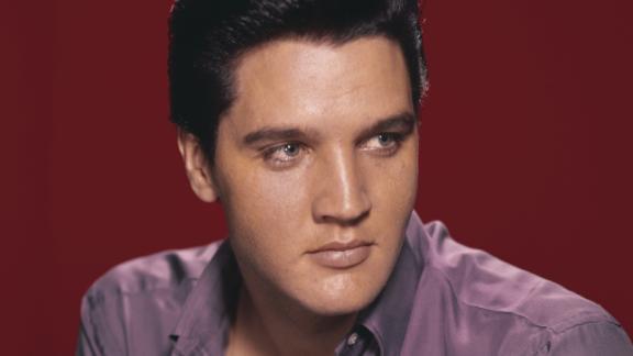 A portrait of cultural icon Elvis Presley circa 1956.