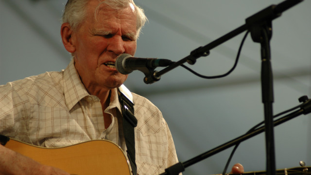Guitarist and singer Doc Watson performs at the New Orleans Jazz and Heritage Festival.