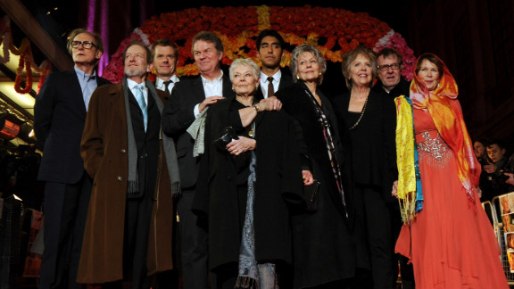"""""""Hotel Marigold"""" actors Bill Nighy, from left, Ronald Pickup, producer Graham Broadbent, director John Madden, actors Judi Dench, Dev Patel, Diana Hardcastle, Penelope Wilton, Tom Wilkinson and Celia Imrie at the premiere of their film in London."""