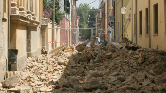 Fallen buildings fill the street in Mirandola; one of the towns closest to the quake