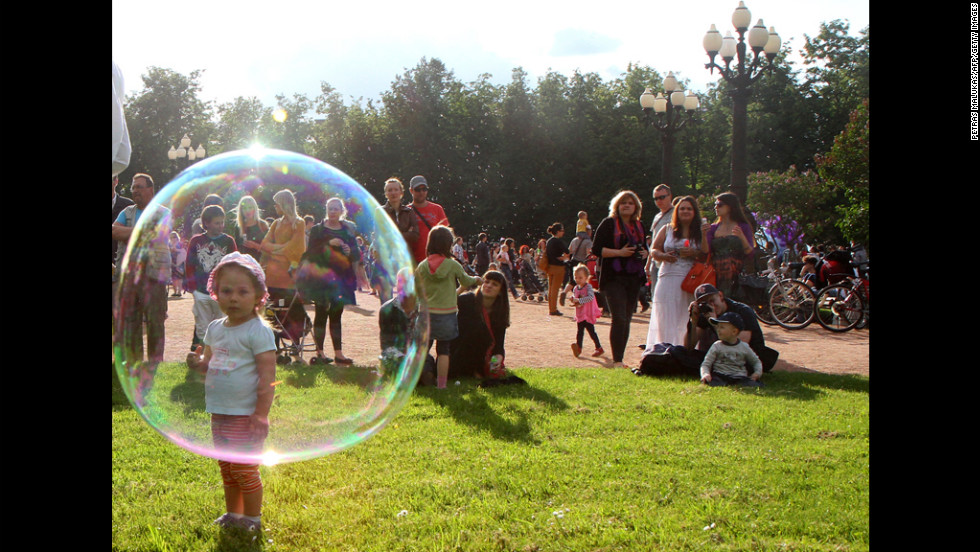 "Soap bubbles are the guest of honor Monday in Vilnius, Lithuania, during ""Burbuliatorius,"" a summer event in at least 15 cities around the world."