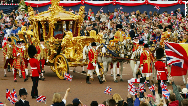 Queen Elizabeth and Prince Philip ride in the Golden State Carriage at the head of a parade along The Mall in London celebrating the Queen's golden jubilee on June 4, 2002 .