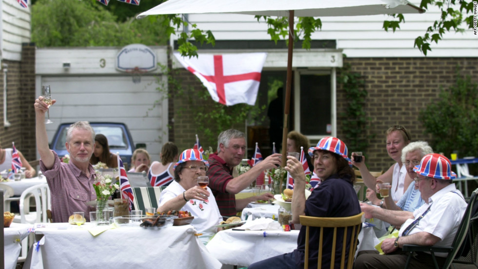 Neighbors mark the Golden Jubilee during one of the numerous street parties held across the United Kingdom in June 2002. More of the same are expected during the Diamond Jubilee celebrations.