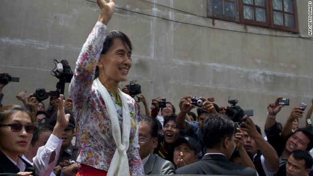 Burmese pro-democracy leader Aung San Suu Kyi waves to Burmese migrant workers on a trip to a Burmese migrant community outside of Bangkok May 30, 2012 in Mahachai, Samut Sakhon, Thailand.