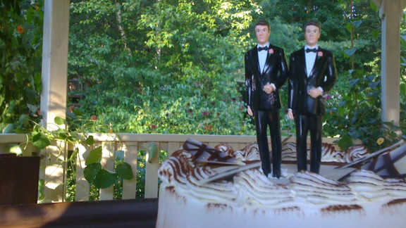 After the ceremony, they had dinner and cake complete with a customized wedding topper. The following month, Mike and Kevin held a wedding reception in their home city of San Antonio for friends and family.