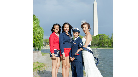 """iReporter Valezka Taylor decided to adopt a sailor theme so her mate, Sami, could wear her Coast Guard uniform. They were inspired to get married after """"don't ask, don't tell"""" was repealed, but it took an extra nudge from her teenage daughter to set the wheels in motion. Valezka's daughter and her aunt were bridesmaids; they wore red and blue to match the sailor theme."""