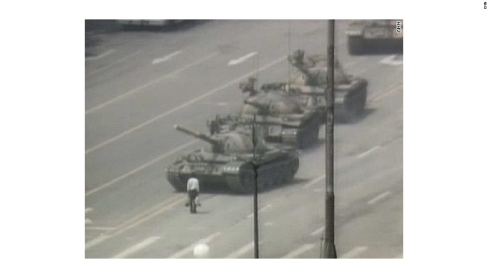 "In this iconic image, an anonymous ""tank man"" stands in protest in front of a column of Chinese tanks on June 5."