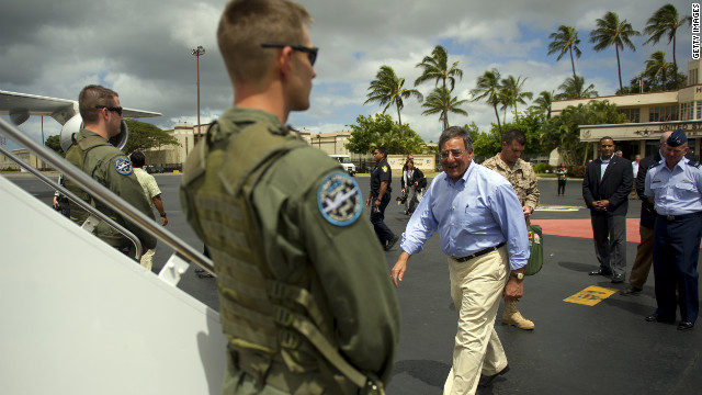 U.S. Secretary of Defense Leon Panetta boards his plane at Hickam Air Force Base in Hawaii on Thursday.