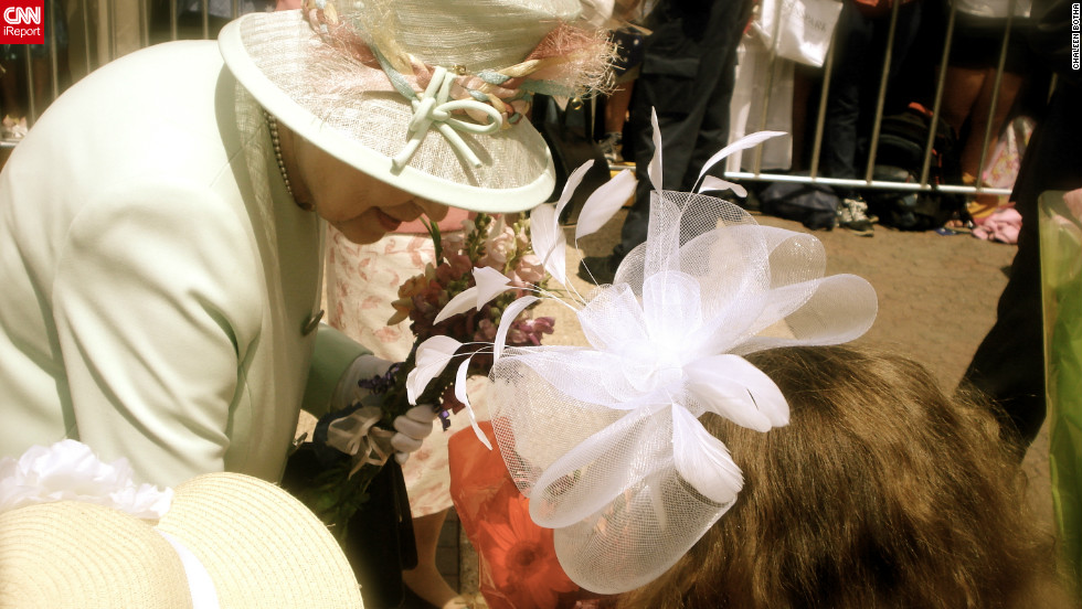 "Queen Elizabeth II accepts a bouquet from nine-year-old Tatum Botha, October 24, 2011. Tatum's mom Chaleen says the meeting was a dream come true for her daughter. ""The Queen said, 'Thank you.' Tatum replied, 'It's a pleasure.'"""
