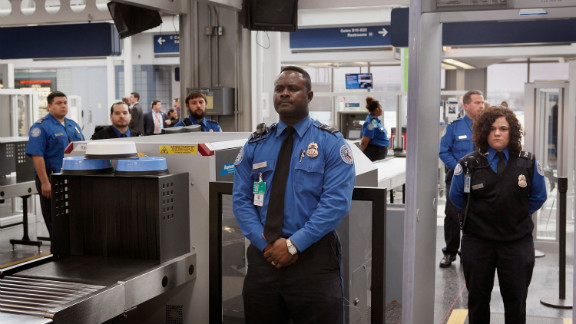 TSA officers staff a checkpoint at O