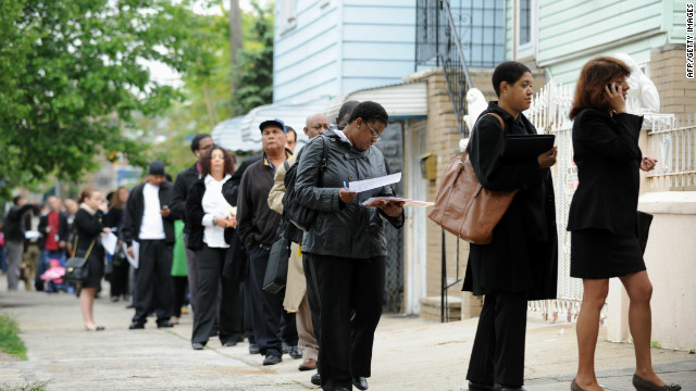 People seeking jobs wait in line at an employment fair in New York in May 2012.