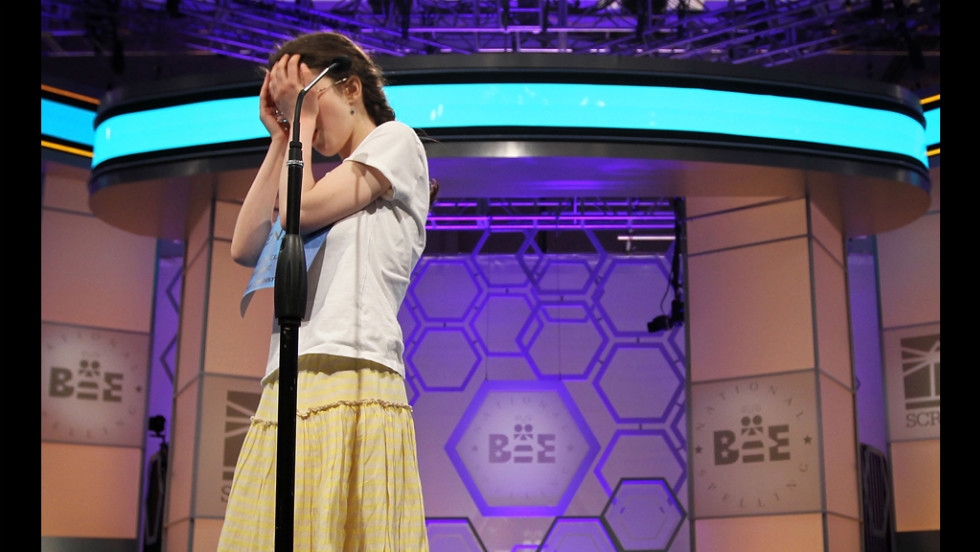 "Speller Lena Greenberg of Philadelphia covers her face during round 9 of the competition after she misspelled the word ""geistlich.""  Greenberg was eliminated from the competition."