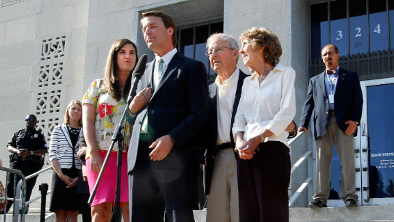 Edwards addresses the media after his acquittal and mistrial, with his daughter Cate and his parents Wallace and Bobbie Edwards at his side, outside the Greensboro courthouse on Thursday, May 31, 2012. After nine days of deliberation, a jury acquitted Edwards on one count but deadlocked on five other counts in his corruption trial. It