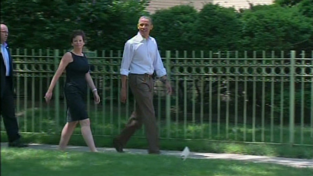 Obama walks in his Chicago neighborhood