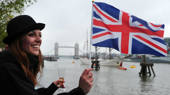 A woman flies a Union flag during the Thames Diamond Jubilee Pageant on the River Thames in London on June 3, 2012.