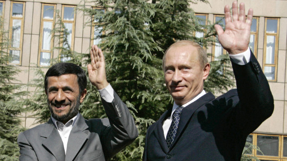 File photo of Iranian President Mahmoud Ahmadinejad, left, and Russian President Vladimir Putin meeting in 2007.
