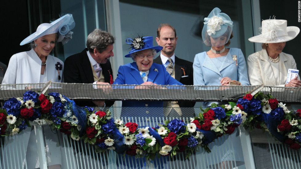 Britain's queen spends a day at the Epsom Derby marking the opening of her Diamond Jubilee weekend on June 2, 2012. Elizabeth II smiles from the royal balcony with Prince Edward, Earl of Wessex behind her.