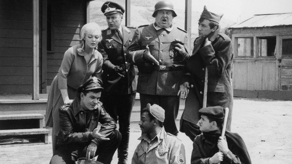 """A promotional image from """"Hogan's Heroes"""" shows the cast clockwise from left: Bob Crane (kneeling), Cynthia Lynn, Werner Klemperer, John Banner, Richard Dawson, Robert Clary and Ivan Dixon."""