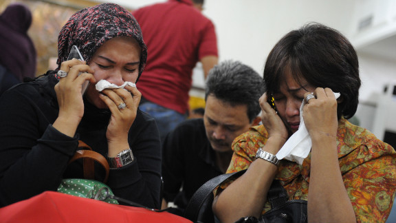 Indonesian relatives mourn at the airport in Jakarta after a Russian Sukhoi Superjet slammed into the side of a volcano on May 9, 2012. Russia