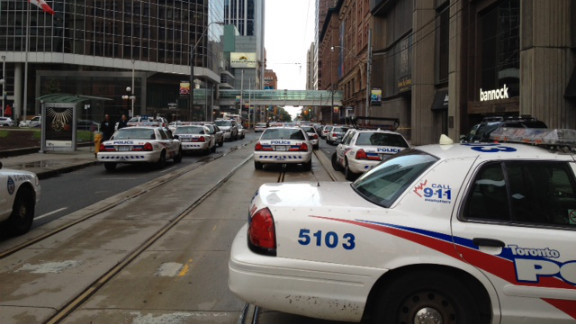 Police, firefighters and paramedics gather at Toronto
